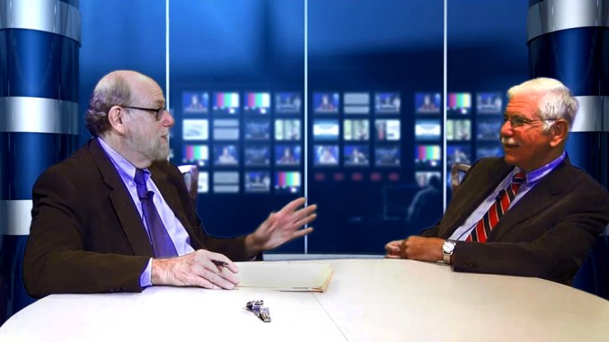 """Rabbi Address chats with Dr. Don Friedman during the taping of """"Conversations"""" TV show."""