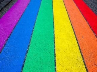 Pride Flag in the Streets of Reykjavik Iceland. Photo by Jasmin Sessler on Unsplash