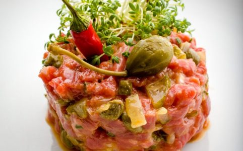 Here is a beef tartare prepared as my son likes it, with plenty of capers, gherkins and a healthy dose of Tabasco.