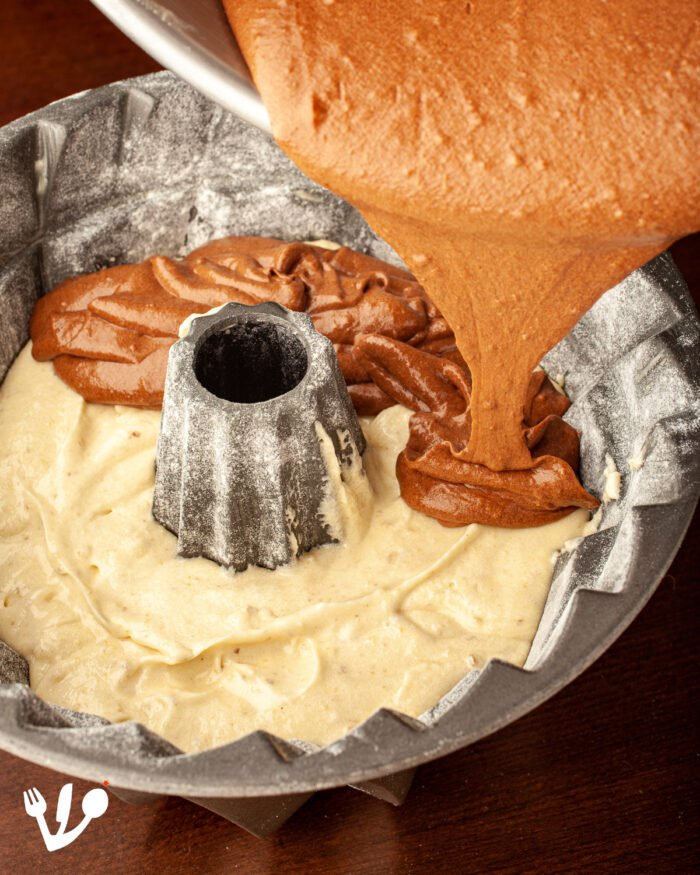 """The walnut-vanilla layer and the coffee-chocolate layer whirl together in this lovely and straightforward """"Marmorgugelhupf"""", this marble Gugelhupf bundt cake."""
