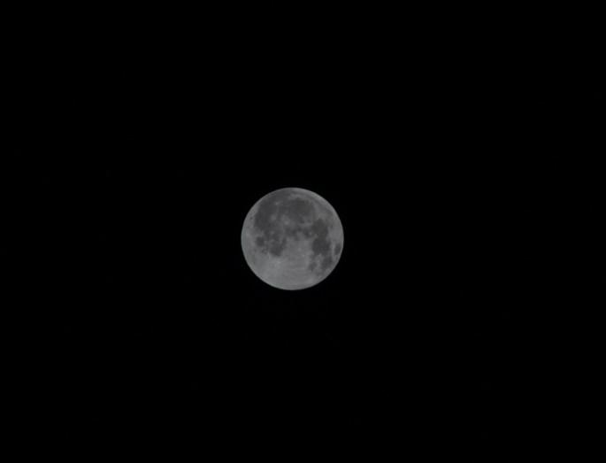 Under exposed full moon