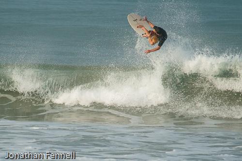 surfer doing an air
