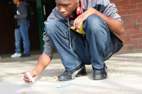 """First Place Best Photography winning photo of live chalk activity on campups titled """"Student Art Month"""" by Alex Ng,"""