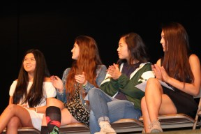 Shooting a smile to one of her best friends, Allison Tanaka (11, far left) gives a look of assurance after Julia Cheng (11) finishes her speech. Tanaka and her fellow class of 2018 candidates, from left to right, Vice Presidential Candidate Hannah Dieckmann (11), secretary candidate Priscilla Lao (11), and competing secretary candidate Gabriella Herrera-Griffe (11) applauded for Cheng's speech, along with the attending audience. (Photo by Saeri Plagmann)