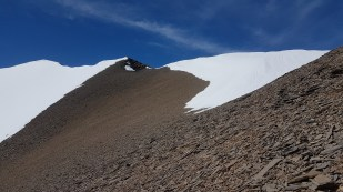 Finished all of our post-holing and looking towards the summit