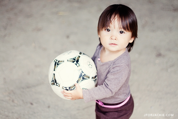 Julienne playing soccer at the park