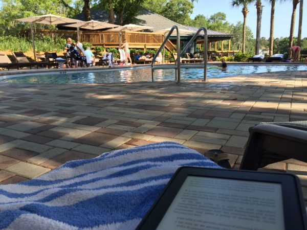 Post conference time, relaxing next to the pool with my Kindle
