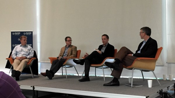 Tom Mullen, Tom Wessel, Josh Brose, and Rick Cobb on stage at Fidelity Investments