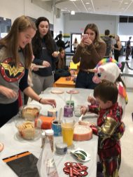 Kids decorate cookies as part of the high school's Spooktacular event. (Photo courtesy King Philip Regional School District)