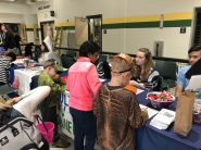 Each high school student group that participated in the ninth annual Spooktacular event decorated a table and offered activities and treats for the kids. (Photo courtesy King Philip Regional School District)