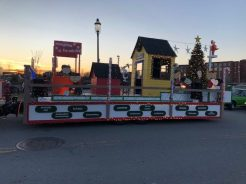 """Greater Lowell Tech students designed and built """"A Charlie Brown Christmas"""" themed parade float for the City of Lowell's 31st Annual City of Lights Holiday Parade. (Courtesy Photo/Greater Lowell Tech)"""
