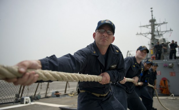 MANAMA, Bahrain (May 10, 2014) Chief Machinist's Mate Donald Morrissey, from Brockton, Mass., heaves a mooring line as the guided-missile destroyer USS Arleigh Burke (DDG 51) arrives for a scheduled port visit in Manama, Bahrain. Arleigh Burke is deployed in the U.S. 5th Fleet area of responsibility supporting maritime security operations and theater security cooperation efforts. (U.S. Navy photo by Mass Communication Specialist 2nd Class Carlos M. Vazquez II/Released)