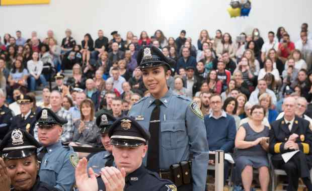 Officer Santos, in her University of Massachusetts Amherst Police Department uniform, at the graduation ceremony for the fifth class of the Northern Essex Community College/Methuen Police Academy in February. (NECC Courtesy Photo)