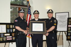 Left-to-Right, Officer Keith Sheppart, Lieutenant Thomas Browne, the department's accreditation manager, and Sergeant Timothy McDonough receive the Accreditation Award.