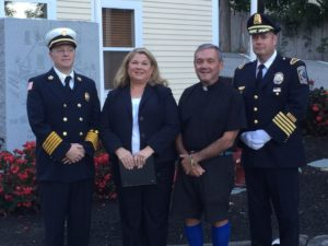 Left to right: Fire Chief Fred Mitchell, Chaplain Lorraine Edwards, Father Rich Burton and Police Chief Donald Cudmore. (Courtesy Photo)