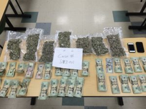 The Chelmsford Police Department seized approximately 1 3/4 pounds of marijuana and $3,055 in cash from a Dracut man.