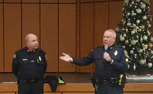 Lt. James Graham (left) and Sgt. Paul Saunders discuss common types of computer, phone and mail scams with residents of Carleton-Williard Village on Dec. 18, 2018. (Courtesy Photo/Bedford Police Department)