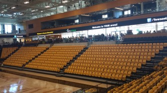 "After a ribbon-ceremony, students crowd into the SECU Arena to see what Towson's Campus has to offer. ""It's always beneficial to get involved,"" graduate, Brandon Haire, said."