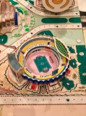 "Kimbembele Ihunga (1994) (Detail): Kingelez places ""Stade Kingelez"", a stadium named after himself, inside his reimagined version of his birthplace."