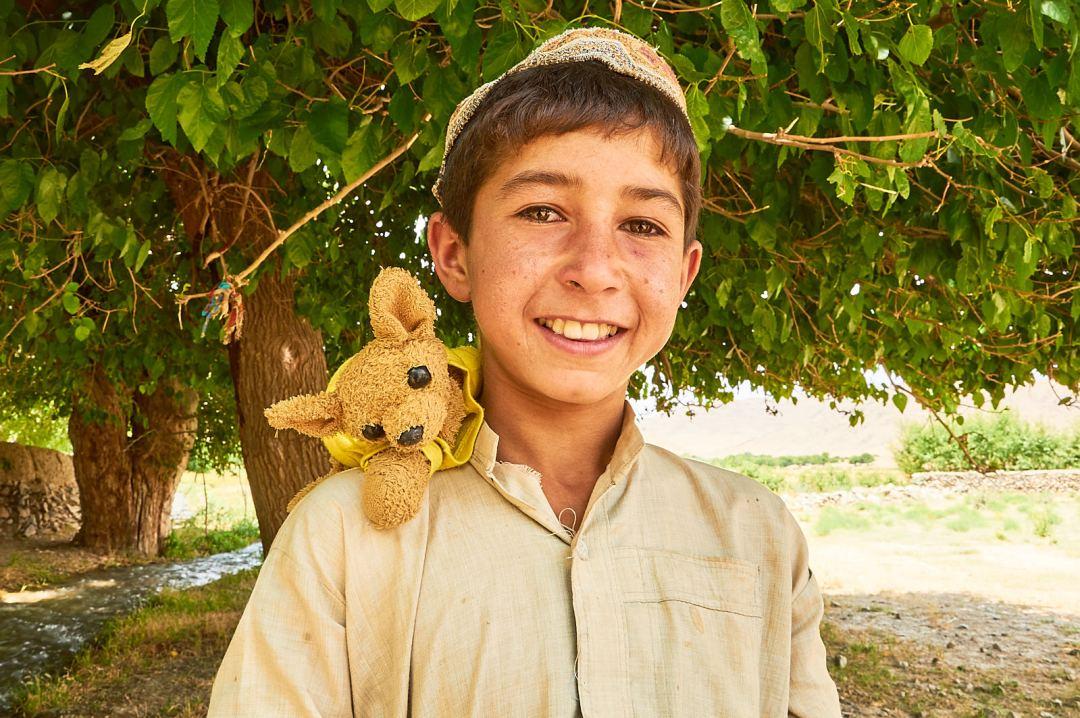 Afghan Kid with Stuffed animal for Adoption Family Photography