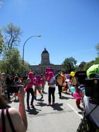 People march as part of the Winnipeg Pride Parade. Photo by Rachel Swatek