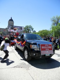 An anti-bullying message is carried on a car in the parade. Photo by Rachel Swatek.