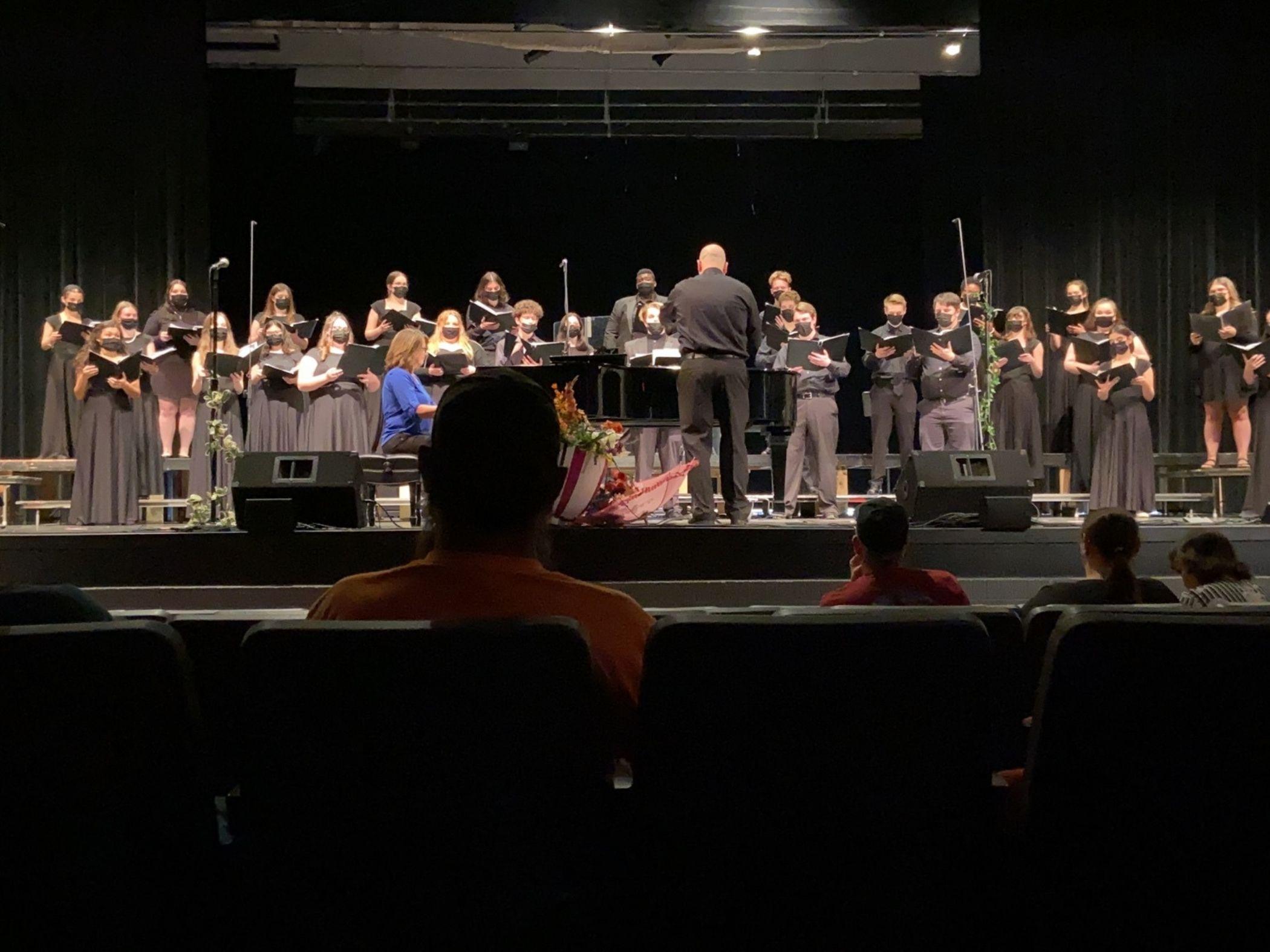 High School Choir on stage in auditorium