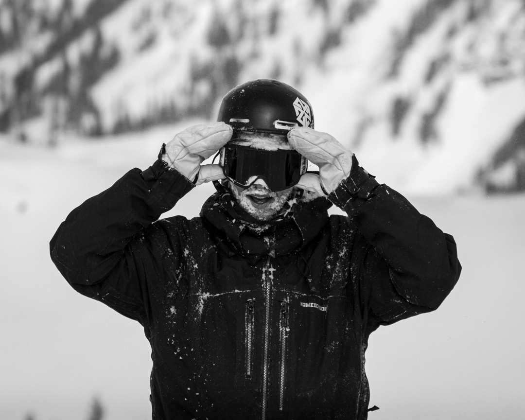 Snowboarder with helmet on.