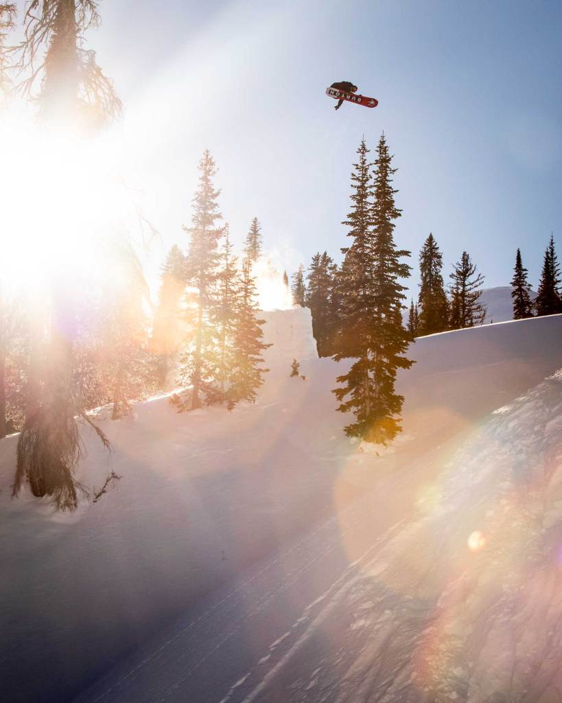 Snowboarder going off a jump.