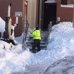 Snow removal at a commercial entrance