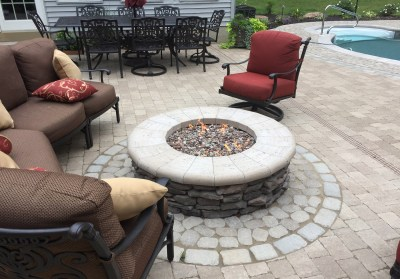 Fire pit as part of an outdoor living and pool project - Photo by Gordon W. Dimmig Photography