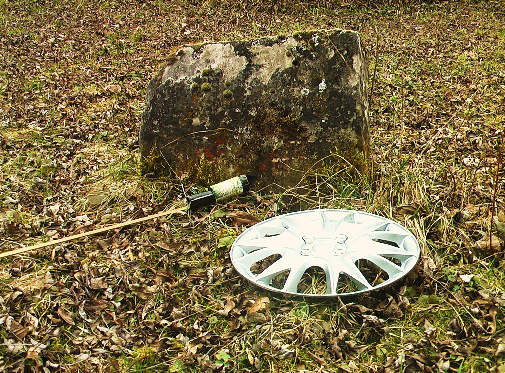 historic grave stone with firework and hubcap
