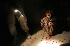 Samar Hassan, 5, screams after her parents were killed by U.S. soldiers with the 25th Infantry Division in a shooting Jan. 18, 2005, in Tal Afar, Iraq. The troops fired on the Hassan family car when it unwittingly approached them during a dusk patrol in the tense northern Iraqi town. Chris Hondros/Getty Images