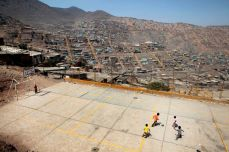 Children play soccer on a concrete field in Bellavista, Peru, a new settlement on the outskirts of Lima, in April 2011. Dieter Telemans/Panos