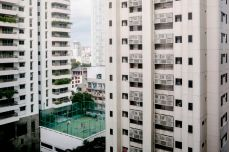 Children play on a soccer field on the roof of an apartment building in Bangkok, Thailand, in July 2013. Ian Teh/Panos