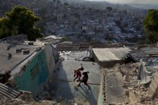 Kids play with a ball among the ruins of a building that was destroyed during the earthquake in the hills surrounding Port-au-Prince, Haiti, in January 2011. Jonathan Torgovnik/Getty