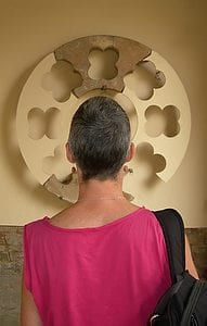 Contemplating a rose window fragment. Photograph by Timothy Charles Geoffrion