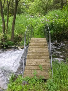 Footbridge over a Minnesota stream by photographer Jill K H Geoffrion