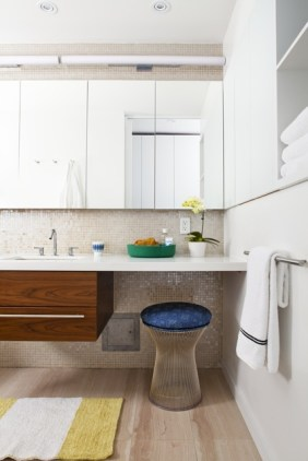 Clean lined bathroom with Knoll accent stool