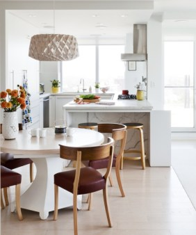 View of kitchen and custom dining table with Scandinavian chairs