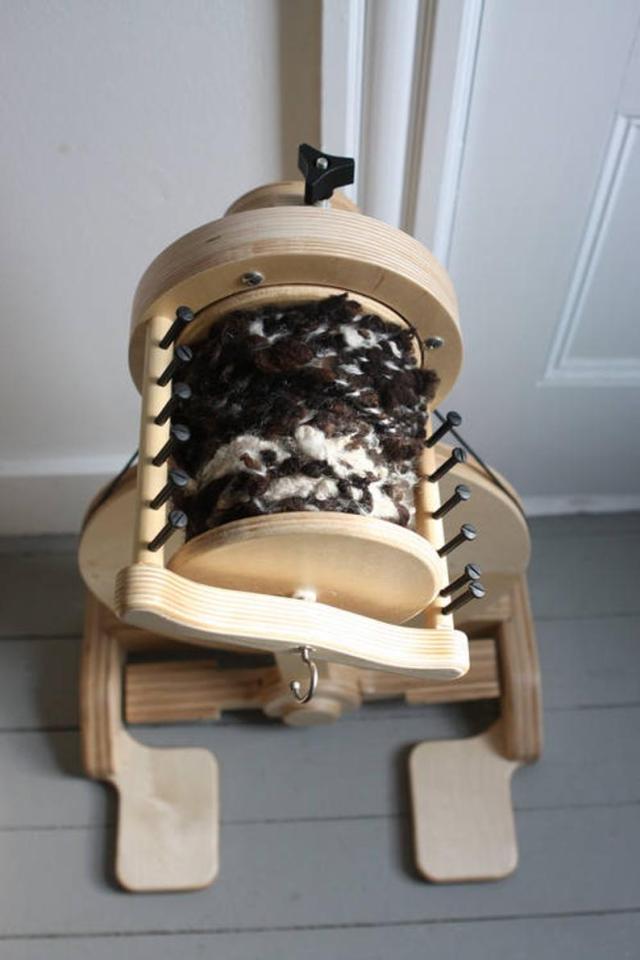 SpinOlution Echo Spinning Wheel with a bobbin full of art yarn