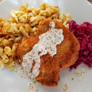Spätzle & Schnitzel with Tart Red Cabbage and Whole Grain Mustard Sauce on a plate