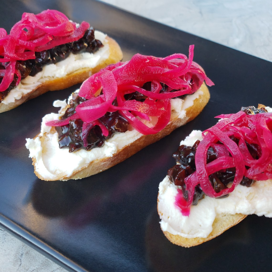 Pancetta Jam Crostini with Mascarpone and pickled red onion