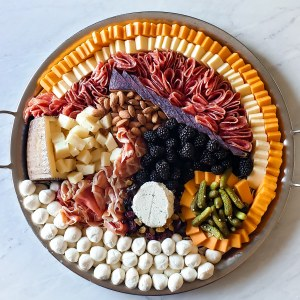 Elaborately laid out circular cheese board