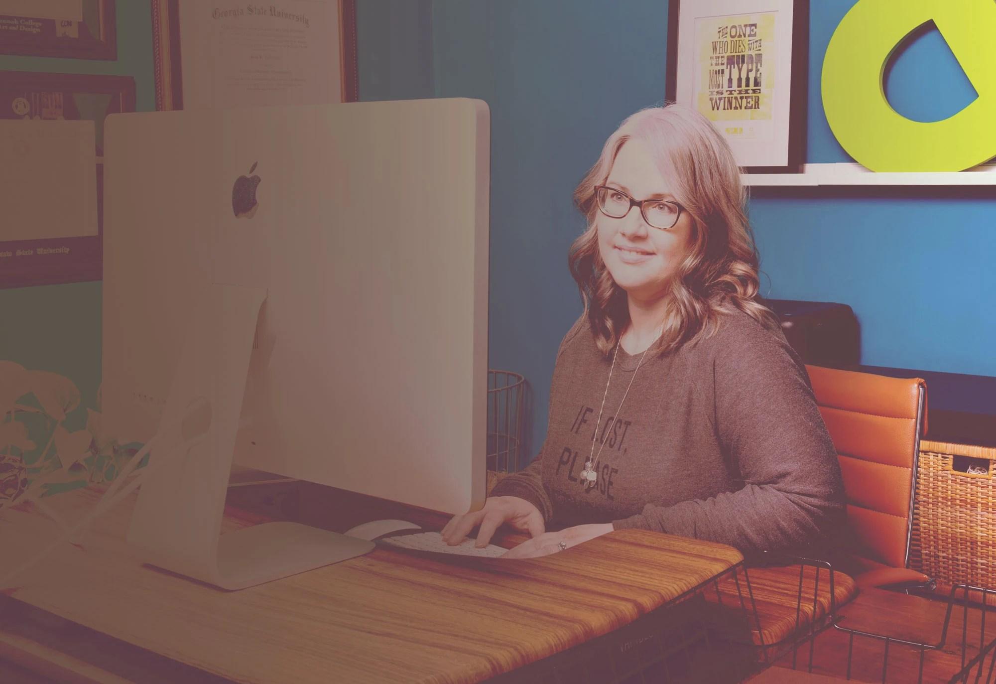 Jill Anderson WordPress designer sitting at computer