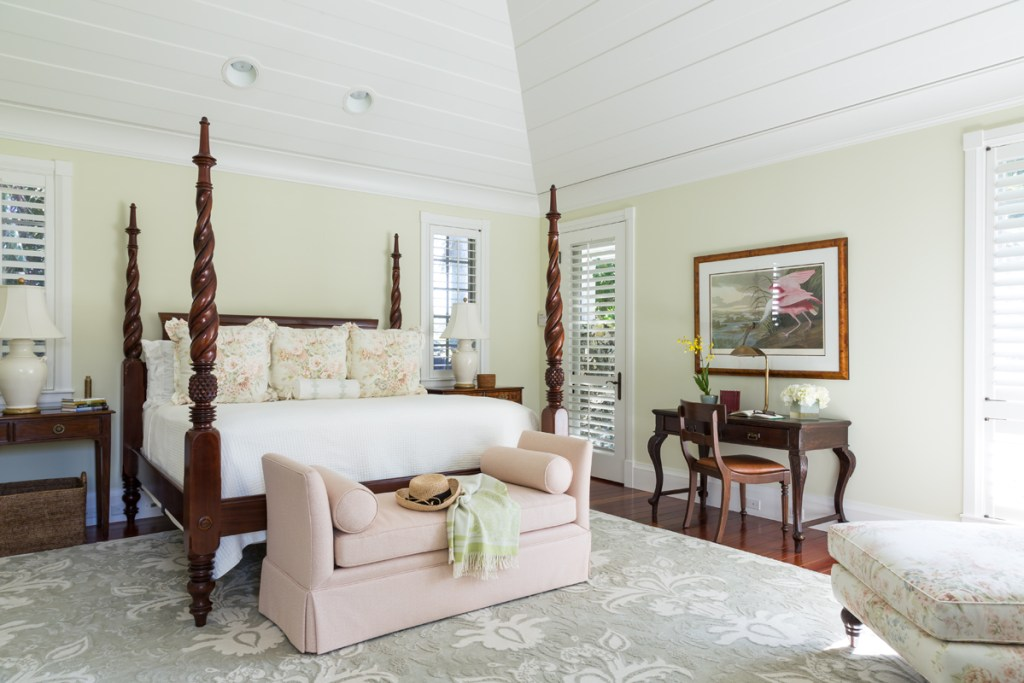 Floral Pattern Pillows on Four Poster Mahogany British West Indies Bed