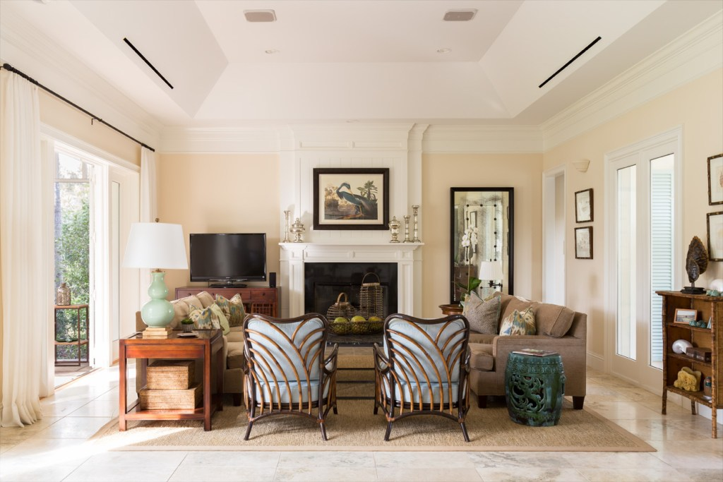 A Traditional Living Room with West Indies Accents White Millwork Faced Fireplace Renovation