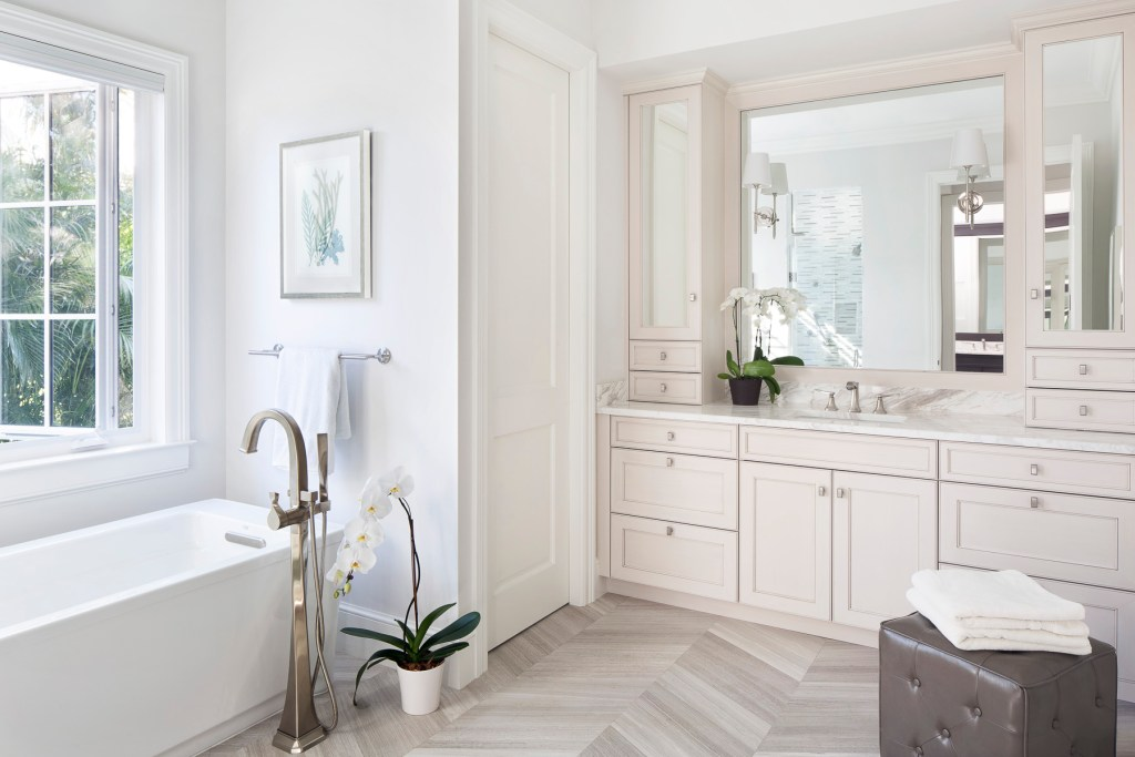A Master Bath of a New Construction Home with a freestanding tub, in Orchid Island