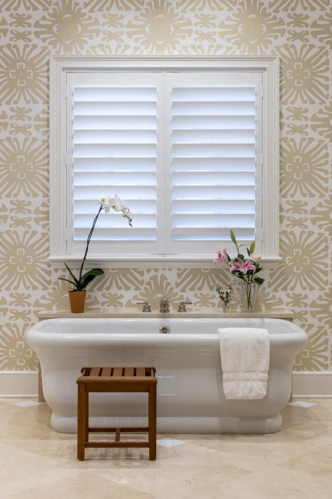 An Orchid Island Vero Beach FL Home Remodel by Interior Designer Jill Shevlin, Master Bath Features a Freestanding Waterworks Empire Tub