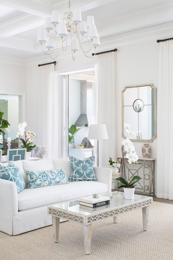White Indoor Outdoor Fabric on a Living Room Sofa with Turquoise Accent Pillows Entry New Construction Project Jill Shevlin Design Vero Beach Interior Designer Orchid Island